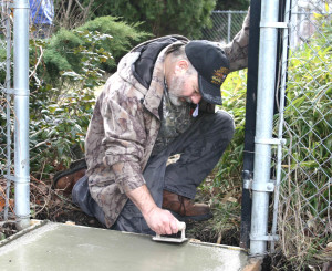SNAP employees and volunteers from HDR Engineers set the foundation for wheelchair ramp at the home.
