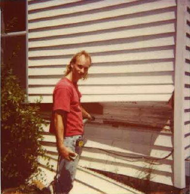 Dave Jacobs insulating a house in 1985